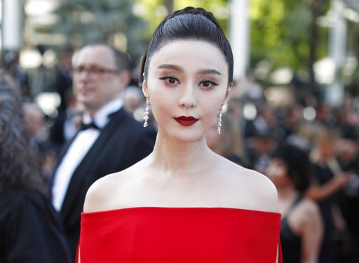 (AP Photo/Thibault Camus, File). FILE - In this May 24, 2017, file photo, Chinese actress Fan Bingbing poses for photographers as she arrives for the screening of the film The Beguiled at the 70th international film festival, Cannes, southern France. T...