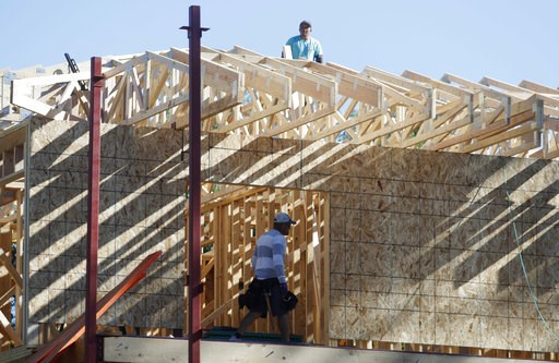 (AP Photo/David Zalubowski, File). FILE- In this Aug. 30, 2018, file photo a workers toil on a new home under construction in Denver. On Wednesday, Oct. 17, the Commerce Department reports on U.S. home construction in September.