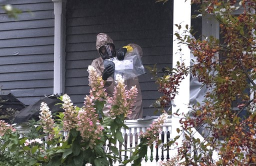 (Gabor Degre/The Bangor Daily News via AP). A person in a hazmat suit appears to be handling a letter that is enclosed in a plastic bag in Bangor, Maine, Monday, Oct. 15, 2018. A hazardous materials team was called Monday to investigate a suspicious le...