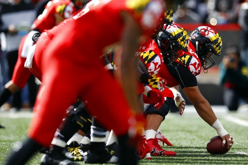 (AP Photo/Patrick Semansky, File). FILE - In this Saturday, Oct. 13, 2018, file photo, Maryland's offensive line gets set to to snap the ball during the second half of an NCAA college football game against Rutgers in College Park, Md. The best offensiv...