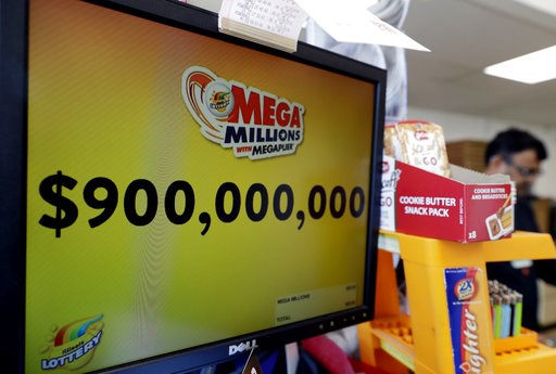 (AP Photo/Nam Y. Huh). The Mega Millions jackpot is displayed at a convenience store Wednesday, Oct. 17, 2018, in Chicago. The Mega Millions jackpot is now up to $900 million. The estimated jackpot for Friday's drawing would be the second-largest lotte...