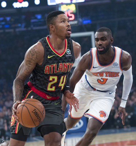 (AP Photo/Mary Altaffer). Atlanta Hawks guard Kent Bazemore (24) drives to the basket against New York Knicks guard Tim Hardaway Jr. (3) during the first half of an NBA basketball game, Wednesday, Oct. 17, 2018, at Madison Square Garden in New York.