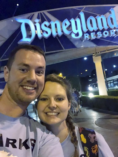 (Clark Ensminger via AP). This Oct. 17, 2018 photo provided by Clark Ensminger, shows him with his wife Heather Ensminger at Disneyland in Anaheim, Calif. The couple visited four Disney parks in the Orlando, Fla., area and two Disney parks in the Los A...