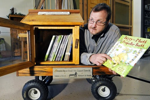 (AP Photo/Jim Mone, File). FILE - In this Dec. 6, 2012 file photo, Todd Bol poses with a Little Free Library lending boxes in Hudson, Wis. Bol, who founded Little Free Library, the boxes of books for sharing that popped up across the U.S. and spread to...