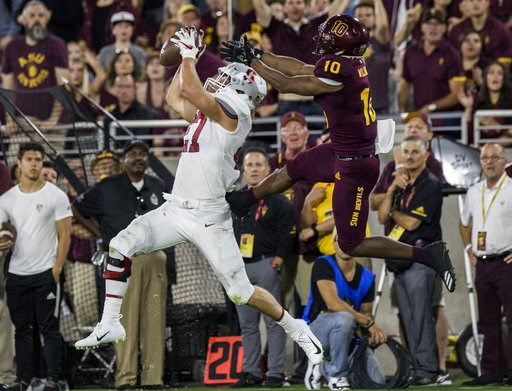 (AP Photo/Darryl Webb). Stanford's Sean Barton intercepts a pass intended for Arizona State's Kyle Williams during the first half of an NCAA college football game Thursday, Oct. 18, 2018, in Tempe, Ariz.