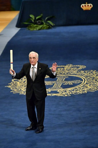 (AP Photo/Alvaro Barrientos). US film director Martin Scorsese gestures after receiving the Princess of Asturias Award for the Arts 2018 from Spain's King Felipe VI at a ceremony in Oviedo, northern Spain, Friday Oct. 19, 2018.