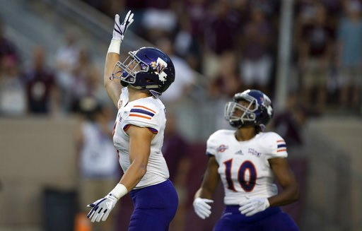 (AP Photo/Sam Craft, File). FILE - In this Aug. 30, 2018, file photo, Northwestern State's Ryan Reed (8) waves for a fair catch on the opening kickoff against Texas A&M during an NCAA college football game, in College Station, Texas. About 1 of eve...