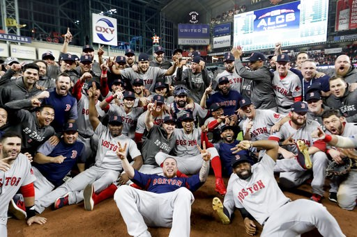 (AP Photo/David J. Phillip). The Boston Red Sox pose for a picture after winning the baseball American League Championship Series against the Houston Astros on Thursday, Oct. 18, 2018, in Houston. Red Sox won 4-1.