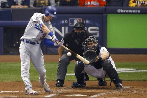 (AP Photo/Charlie Riedel). Los Angeles Dodgers' Cody Bellinger (35) hits a two-run home run during the second inning of Game 7 of the National League Championship Series baseball game against the Milwaukee Brewers Saturday, Oct. 20, 2018, in Milwaukee.