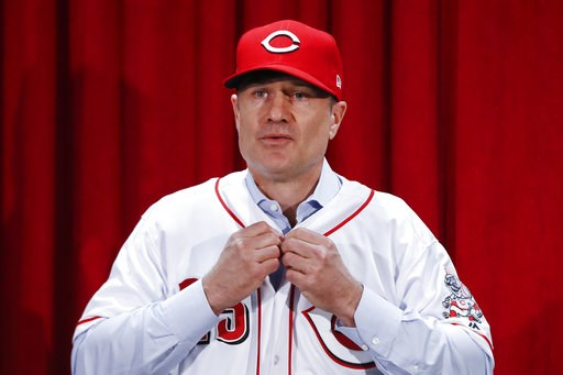(AP Photo/John Minchillo). Cincinnati Reds manager David Bell puts on his number 25 jersey during a news conference, Monday, Oct. 22, 2018, in Cincinnati. Bell has been hired as manager of the Cincinnati Reds, tasked with helping turn around a team tha...