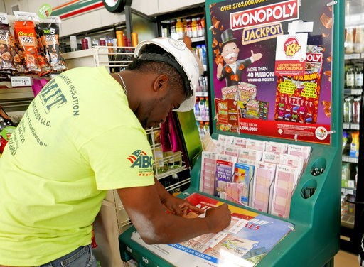 (AP Photo/John Raoux). Jean Pierre fills out several Mega Millions lottery tickets for purchase at a convenience store Monday, Oct. 22, 2018, in Orlando, Fla. No one won the $1 billion jackpot in Saturday night's drawing, which means the top prize for ...