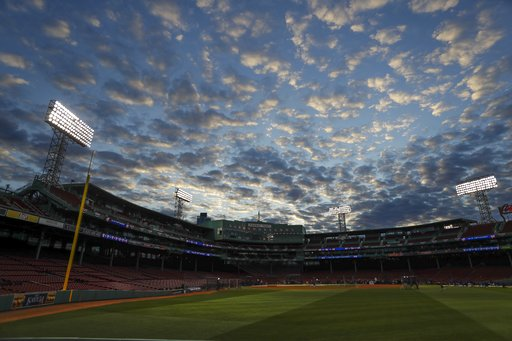 (AP Photo/Matt Slocum). Clouds fill the sky over Fenway Park as the Los Angeles Dodgers practice for Game 1 of the World Series baseball game against the Boston Red Sox Monday, Oct. 22, 2018, in Boston.