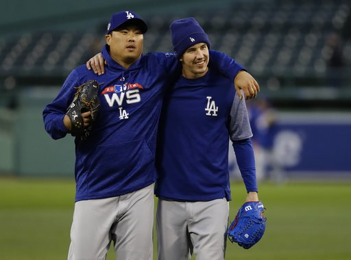 (AP Photo/Matt Slocum). Los Angeles Dodgers' Hyun-Jin Ryu and Walker Buehler practice for Game 1 of the World Series baseball game against the Boston Red Sox Monday, Oct. 22, 2018, in Boston.