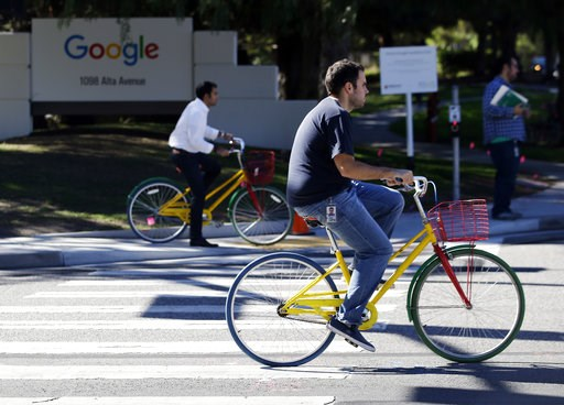 (AP Photo/Marcio Jose Sanchez, File). FILE - In this Oct. 20, 2015 file photo, employees ride company bicycles outside Google headquarters in Mountain View, Calif. Hundreds of Google employees are expected to temporality leave their jobs Thursday morni...