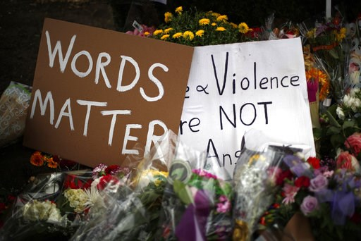 (AP Photo/Gene J. Puskar). Flowers surround signs on Wednesday, Oct. 31, 2018, part of a makeshift memorial outside the Tree of Life Synagogue to the 11 people killed during worship services Saturday Oct. 27, 2018 in Pittsburgh.