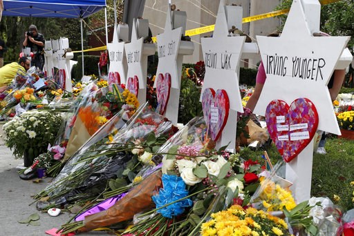(AP Photo/Gene J. Puskar). Flowers surround Stars of David on Wednesday, Oct. 31, 2018, part of a makeshift memorial outside the Tree of Life Synagogue to the 11 people killed during worship services Saturday Oct. 27, 2018 in Pittsburgh.