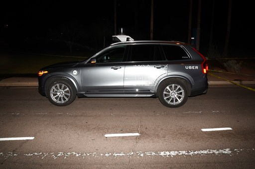 (Tempe Police Department via AP, File). FILE - This file photo provided by the Tempe Police Department shows an Uber SUV after hitting a woman on March 18, 2018, in Tempe, Ariz.  Nearly eight months after one of its autonomous test vehicles hit and kil...