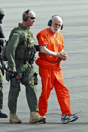 "(Stuart Cahill/The Boston Herald via AP, File). FILE - In this June 30, 2011 file photo, James ""Whitey"" Bulger, right, is escorted from a U.S. Coast Guard helicopter to a waiting vehicle at an airport in Plymouth, Mass., after attending hearings in fed..."