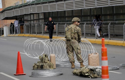 (AP Photo/Eric Gay). Members of the U.S.military place razor wire along the U.S.-Mexico border on the McAllen-Hidalgo International Bridge, Friday, Nov. 2, 2018, in McAllen, Texas.