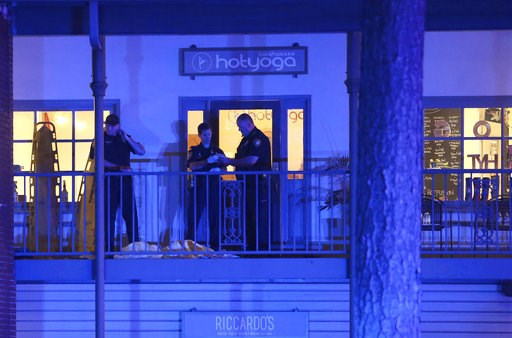 (AP Photo/Steve Cannon). Police investigators work the scene of a shooting, Friday, Nov. 2, 2018, in Tallahassee, Fla.  A shooter killed one person and critically wounded four others at a yoga studio in Florida's capital before killing himself Friday, ...