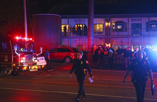 (AP Photo/Steve Cannon). Police investigators work the scene of a shooting, Friday, Nov. 2, 2018, in Tallahassee, Fla. A shooter killed one person and critically wounded four others at a yoga studio in Florida's capital before killing himself Friday, o...