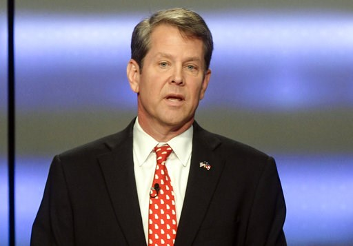 (AP Photo/John Amis, File). FILE - In this May 20, 2018, file photo, Georgia Republican gubernatorial candidate Brian Kemp participates in a debate in Atlanta.  Former President Jimmy Carter is wading into the final days of a Georgia governor's race th...