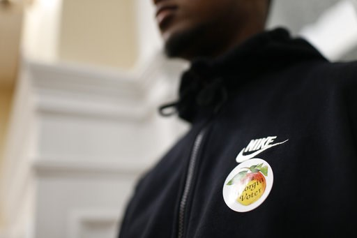 (Joshua L. Jones/Athens Banner-Herald via AP). A Cedar Shoals students with an I'm a Georgia voter sticker looks on as fellow students discuss local issues with County Commissioners Mariah Parker and Tim Denson during a field trip to City Hall and the ...