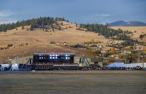 (AP Photo/Carolyn Kaster, file). In this Oct. 18, 2018, file photo, a campaign rally is seen from the motorcade, with President Donald Trump aboard, at Minuteman Aviation Hangar in Missoula, Mont. Trump is in the final stretch of a 44-city blitz for th...