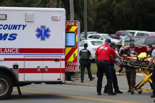 (Tori Schneider/Tallahassee Democrat via AP). A person is transported from scene of a shooting, Friday, Nov. 2, 2018, in Tallahassee, Fla. A shooter killed one person and critically wounded four others at a yoga studio in Florida's capital before killi...