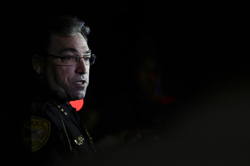 (Tori Schneider/Tallahassee Democrat via AP). Tallahassee police chief Michael DeLeo speaks to the press at the scene of a shooting, Friday, Nov. 2, 2018, in Tallahassee, Fla. A shooter killed one person and critically wounded four others at a yoga stu...