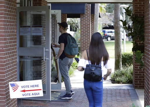(AP Photo/John Raoux). In this  Wednesday, Oct. 31, 2018 photo, students enter a polling place to cast their ballots during a Vote for Our Lives event at the University of Central Florida in Orlando, Fla. Nine months after 17 classmates and teachers we...