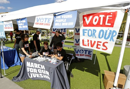 (AP Photo/John Raoux). In this Wednesday, Oct. 31, 2018 photo, student volunteers help out at a booth to encourage on campus voting for students during a Vote for Our Lives event at the University of Central Florida in Orlando, Fla. Nine months after 1...