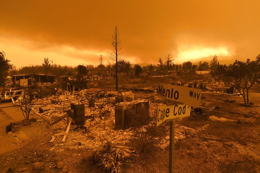 (AP Photo/Noah Berger, File). FILE - In this July 27, 2018, file photo, homes leveled by the Carr Fire line are seen in the Lake Keswick Estates area of Redding, Calif.  More than 80 families who lost their homes in California's deadly Carr Fire in Jul...