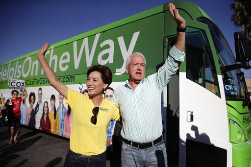 (AP Photo/Jae C. Hong). Republican gubernatorial candidate John Cox, right, and Young Kim, a candidate running for a U.S. House seat in the 39th District in California, wave to their supporters during a campaign stop Saturday, Nov. 3, 2018, in Rowland ...