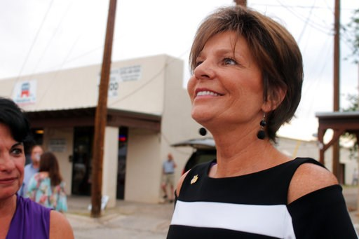 (Jacqueline Devine/Daily News via AP, File). FILE - In this June 5, 2018, file photo, State Rep. Yvette Herrell smiles as she discovers she is in the lead in the Republican primary for New Mexico's 2nd Congressional District race in Alamogordo, N.M. Mo...