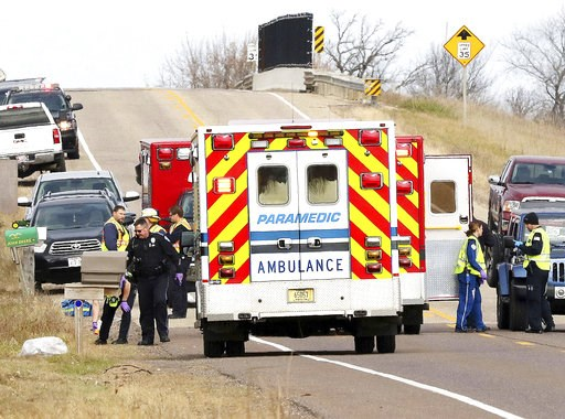 (Steve Kinderman/The Eau Claire Leader-Telegram via AP). Emergency medical personnel gather at the scene of a hit-and-run accident Saturday, Nov. 3, 2018, in Lake Hallie, Wis., that killed two girls and an adult.