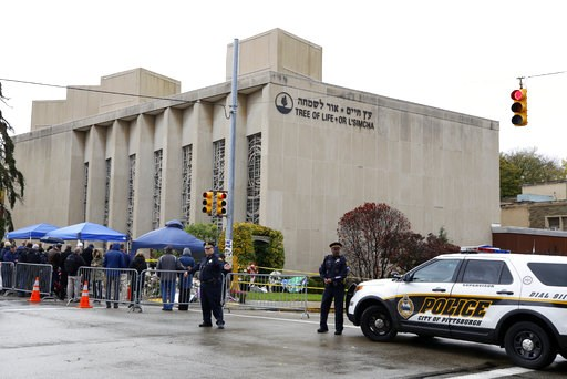 (AP Photo/Gene J. Puskar). Pittsburgh Police direct traffic as their vehicles close the street adjacent to the Tree of Life Synagogue on Saturday, Nov. 3, 2018, as a curbside Shabbat morning service is held on the street corner in the Squirrel Hill nei...