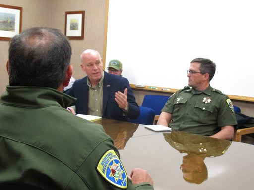 (AP Photo/Matt Volz). In this Oct. 9, 2018 Rep. Greg Gianforte speaks during a meeting with leaders from the Montana Department of Justice and Montana Highway Patrol in Helena, Mont.. Gianforte is running against Democratic challenger Kathleen Williams...