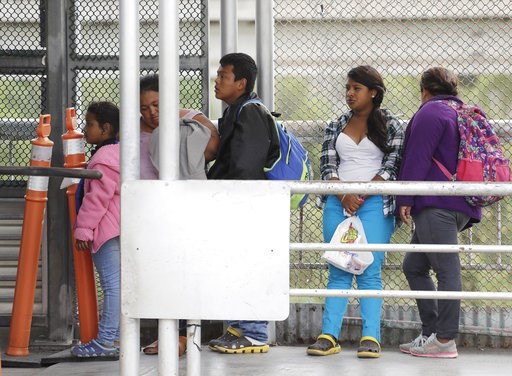(AP Photo/Eric Gay, File). FILE- In this Saturday, Nov. 3, 2018, file photo immigrants seeking asylum in the United States wait on the the International Bridge in Reynosa, Mexico. Asylum seekers already camping at border crossings worry that how the Tr...