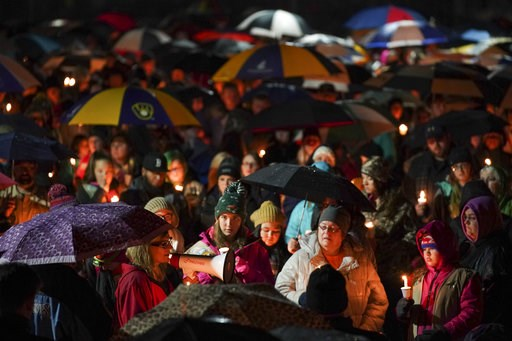 (Jeff Wheeler/Star Tribune via AP). Sherri Jasper, a Girl Scout board member and counselor at Halmstad Elementary School, leads the program for a candlelight vigil at the school in Chippewa Falls, Wis., Sunday evening, Nov. 4, 2018. The western Wiscons...