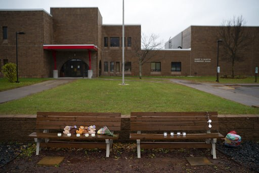 (Jeff Wheeler/Star Tribune via AP). Teddy bears, flowers, and candles were placed on benches outside Halmstad Elementary School in Chippewa Falls, Wis. as a memorial to the three Girl Scouts who were struck and killed by a driver who fled the scene, Su...