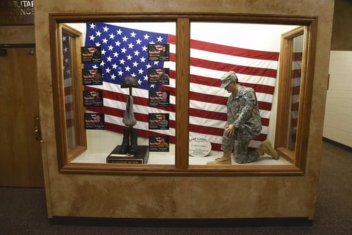 (Francisco Kjolseth/The Salt Lake Tribune, via AP). The Fallen Soldier Tribute is shown at the Utah Army National Guard Recruiting building Sunday, Nov. 4, 2018, in Draper, Utah. Military officials say a major in Utah's Army National Guard who was also...