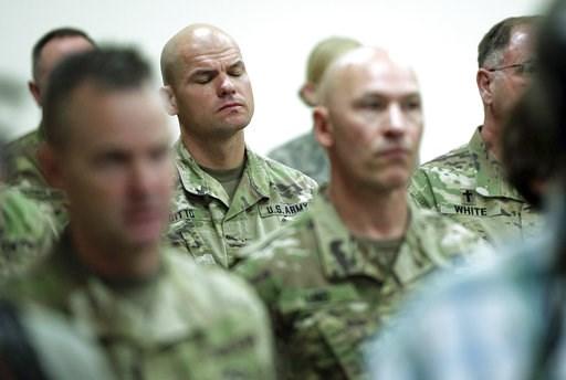 (Francisco Kjolseth/The Salt Lake Tribune, via AP). Soldiers attend a news conference where Gov. Gary R. Herbert and Maj. Gen. Jefferson S. Burton address the media Sunday, Nov. 4, 2018, in Draper, Utah. Military officials say a major in Utah's Army Na...