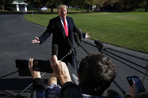 (AP Photo/Jacquelyn Martin). President Donald Trump answers a question from the media as he leaves the White House, Sunday, Nov. 4, 2018, in Washington, en route to rallies in Macon, Ga., and Chattanooga, Tenn.
