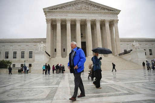 (AP Photo/Pablo Martinez Monsivais). Alaska resident John Sturgeon walks outside the Supreme Court, Monday, Nov. 5, 2018 in Washington. Sturgeon sued the Park Service in 2011 after it told him to stop operating his hovercraft on stretch of the Nation r...