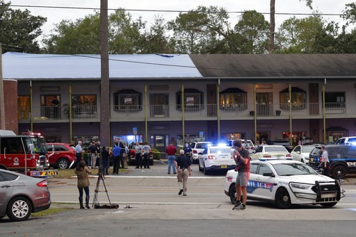 (Tori Schneider/Tallahassee Democrat via AP). Police investigators work the scene of a shooting, Friday, Nov. 2, 2018, in Tallahassee, Fla. A shooter killed one person and critically wounded four others at a yoga studio in Florida's capital before kill...