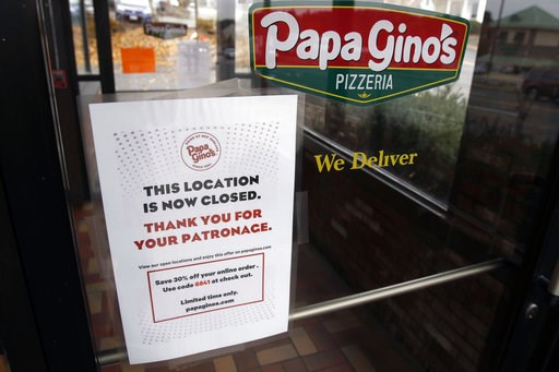 (AP Photo/Bill Sikes). A sign posted Monday, Nov. 5, 2018, on the door of a Papa Gino's Pizzeria location in Marlborough, Mass., states that it is now closed. The company that owns the the pizza parlor and D'Angelo sandwich shop chains confirmed it clo...