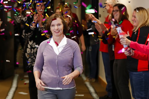 (AP Photo/Charlie Neibergall). Lerynne West, of Redfield, Iowa, arrives to claim her share of a nearly $700 million Powerball prize, Monday, Nov. 5, 2018, at the Iowa Lottery headquarters in Clive, Iowa. West was one of two winners of a $688 million ja...