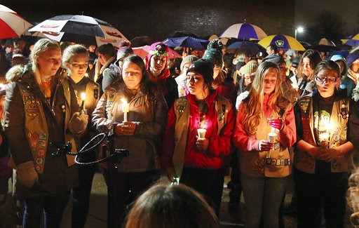 (Steve Kinderman/The Eau Claire Leader-Telegram via AP). Girl Scouts sing as hundreds of community members turn out in the rain Sunday evening, Nov. 4, 2018, for a candlelight vigil at Halmstad Elementary School in Chippewa Falls, Wis., in remembrance ...