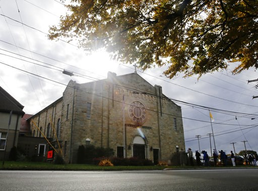 (AP Photo/Frank Franklin II). Members of the media gather outside of Infant of Prague Parish before a news conference with Bishop Richard Malone, of Buffalo, Monday, Nov. 5, 2018, in Cheektowaga, N.Y. Malone has resisted calls to step down amid reports...